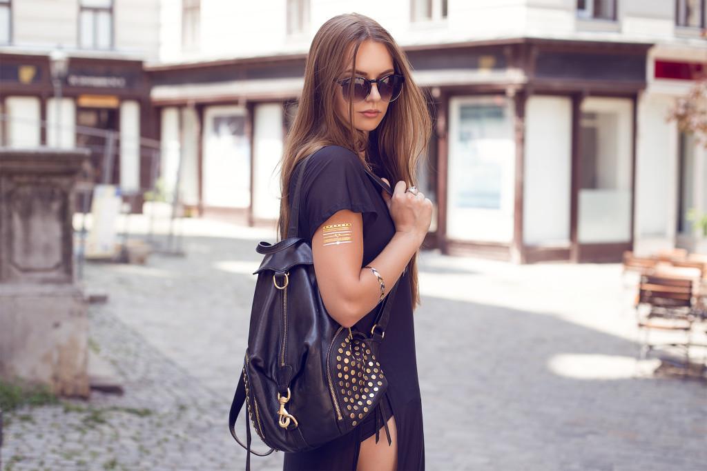 Herpistolgo, Annika is wearing a black milk dress, flash tattoos, PRTTY, ZeroUV, sunglasses, backpack