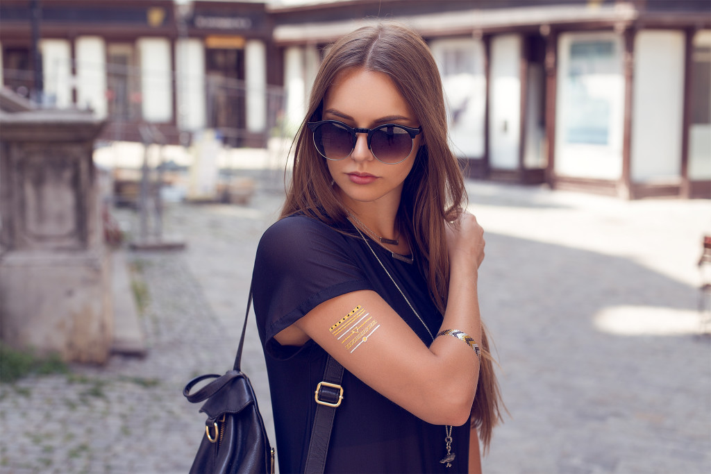 Herpistolgo, Annika is wearing ZeroUV shades, Black Milk Dress, gold tattoo, flash tattoos, PRTTY